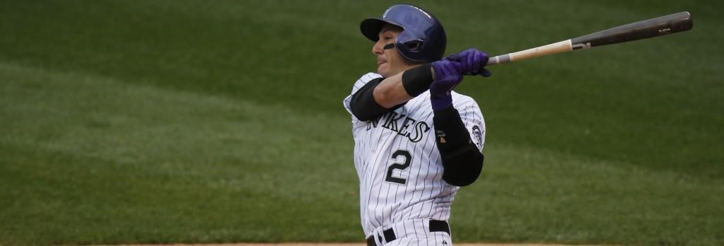 Colorado Rockies shortstop Troy Tulowitzki (2) fouls off a pitch against the Arizona Diamondbacks in the fourth inning of the first game of a baseball doubleheader Wednesday, May 6, 2015, in Denver. (AP Photo/David Zalubowski)