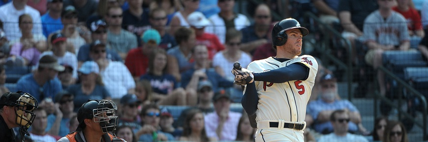 Atlanta Braves first baseman Freddie Freeman (5) swings during the fifth inning of their baseball game against the San Francisco Giants at Turner Field, Saturday, June 15, 2013, in Atlanta. (AP Photo/David Tulis)