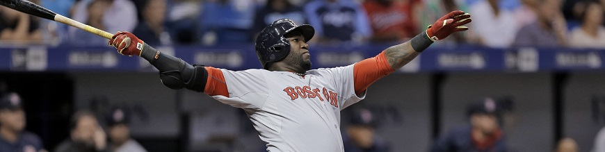 Boston Red Sox's David Ortiz follows through on a home run off Tampa Bay Rays starting pitcher Nathan Karns during the fifth inning of a baseball game Wednesday, April 22, 2015, in St. Petersburg, Fla. Catching for the Rays is Rene Rivera. (AP Photo/O'Meara)