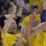 The crowd cheers after Golden State Warriors guard Stephen Curry (30) scored during the first half of Game 2 in a second-round NBA playoff basketball series against the Memphis Grizzlies, Tuesday, May 5, 2015, in Oakland, Calif. (AP Photo/Ben Margot)