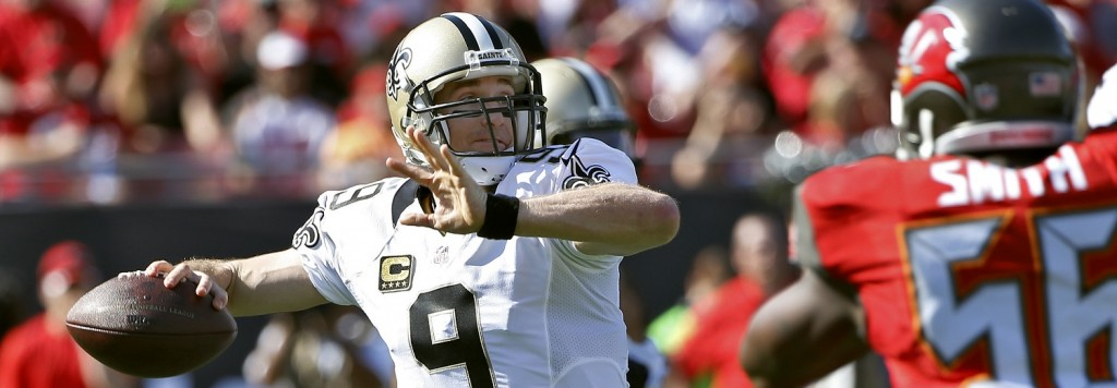 New Orleans Saints quarterback Drew Brees (9) throws a pass as he is pressured by Tampa Bay Buccaneers defensive end Jacquies Smith (56) during the first quarter of an NFL football game Sunday, Dec. 28, 2014, in Tampa, Fla. (AP Photo/Brian Blanco)