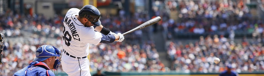 Detroit Tigers' J.D. Martinez singles as Texas Rangers catcher Chris Gimenez works behind the plate during the first inning of a baseball game at Comerica Park Sunday, Aug. 23, 2015, in Detroit. (AP Photo/Duane Burleson)