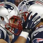 New England Patriots tight end Rob Gronkowski, left, celebrates after catching a touch pass from quarterback Tom Brady, right, in the second half of an NFL football game against the Denver Broncos on Sunday, Nov. 2, 2014, in Foxborough, Mass. (AP Photo/Elise Amendola)