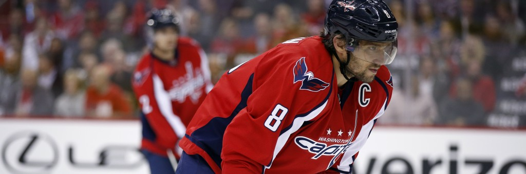Washington Capitals left wing Alex Ovechkin (8), from Russia, pauses on the ice in the first period of an NHL hockey game against the Dallas Stars, Thursday, Nov. 19, 2015, in Washington. (AP Photo/Alex Brandon)
