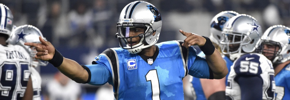 Carolina Panthers quarterback Cam Newton (1) celebrates a first down against the Dallas Cowboys in the second half of an NFL football game, Thursday, Nov. 26, 2015, in Arlington, Texas. The Panthers won 33-14. (AP Photo/Michael Ainsworth)
