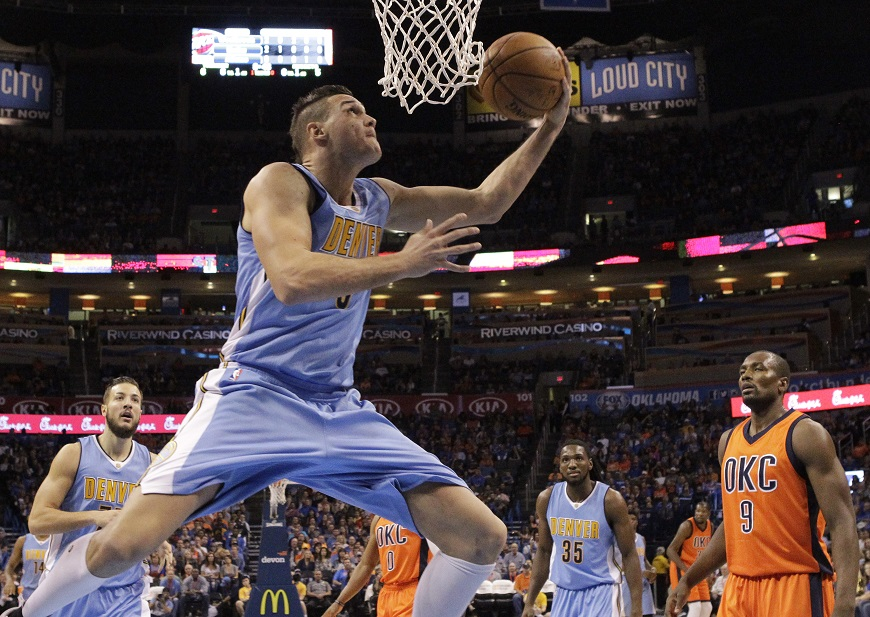 Denver Nuggets forward Danilo Gallinari (8) goes up for a shot in front of Oklahoma City Thunder forward Serge Ibaka (9) in the first quarter of an NBA basketball game in Oklahoma City, Sunday, Nov. 1, 2015. Oklahoma City won 117-93. (AP Photo/Sue Ogrocki)