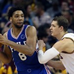 Philadelphia 76ers center Jahlil Okafor (8) against Cleveland Cavaliers center Timofey Mozgov (20) during the second half of an NBA basketball game Friday, Nov. 6, 2015, in Cleveland. The Cavaliers won 108-102. (AP Photo/Ron Schwane)