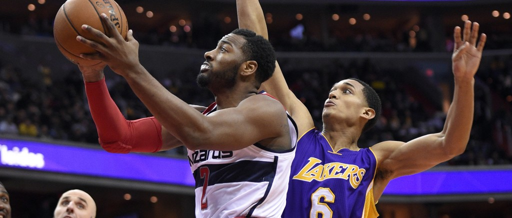 Washington Wizards guard John Wall (2) goes to the basket against Los Angeles Lakers guard Jordan Clarkson (6) during the second half of an NBA basketball game, Wednesday, Dec. 2, 2015, in Washington. The Lakers won 108-104. (AP Photo/Nick Wass)
