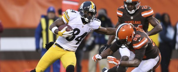 Pittsburgh Steelers wide receiver Antonio Brown (84) tries to block Cleveland Browns linebacker Karlos Dansby (56) after a pass reception during the second half of an NFL football game, Sunday, Jan. 3, 2016, in Cleveland. (AP Photo/Ron Schwane)