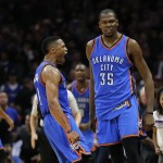 Oklahoma City Thunder's Kevin Durant, right, and Russell Westbrook celebrate their team's 100-99 win against the Los Angeles Clippers in an NBA basketball game, Monday, Dec. 21, 2015, in Los Angeles. (AP Photo/Jae C. Hong)