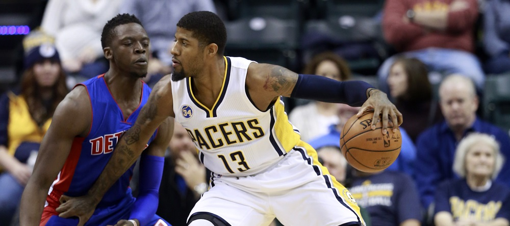 Indiana Pacers forward Paul George (13) drives on Detroit Pistons guard Reggie Jackson during the first half of an NBA basketball game, Saturday, Jan. 2, 2016, in Indianapolis. (AP Photo/R Brent Smith)