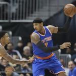 New York Knicks forward Carmelo Anthony (7) works against Atlanta Hawks forward Kent Bazemore (24) in the first half of an NBA basketball game  Tuesday, Jan. 5, 2016, in Atlanta. (AP Photo/John Bazemore)