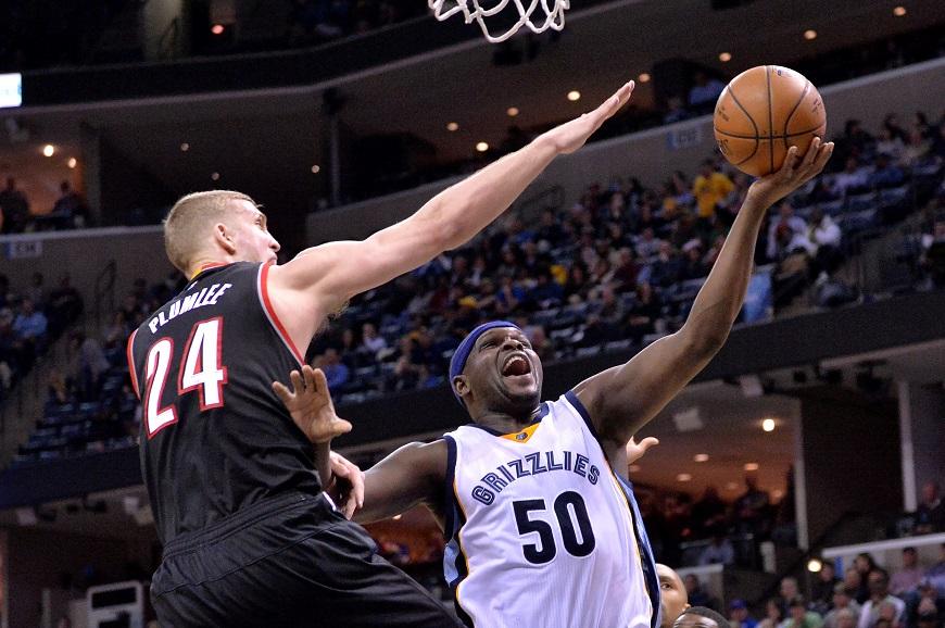Memphis Grizzlies forward Zach Randolph (50) shoots against Portland Trail Blazers center Mason Plumlee (24) in the second half of an NBA basketball game Monday, Feb. 8, 2016, in Memphis, Tenn. (AP Photo/Brandon Dill)