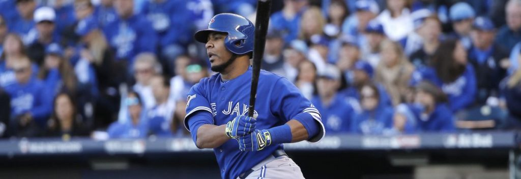 Toronto Blue Jays' Edwin Encarnacion watches his RBI single against the Kansas City Royals during the sixth inning in Game 2 of baseball's American League Championship Series on Saturday, Oct. 17, 2015, in Kansas City, Mo. (AP Photo/Matt Slocum)