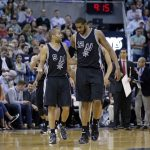 San Antonio Spurs' Tony Parker (9) and LaMarcus Aldridge (12) talk on the court during the second half of an NBA basketball game against the Utah Jazz Tuesday, April 5, 2016, in Salt Lake City. The Spurs won 88-86. (AP Photo/Rick Bowmer)