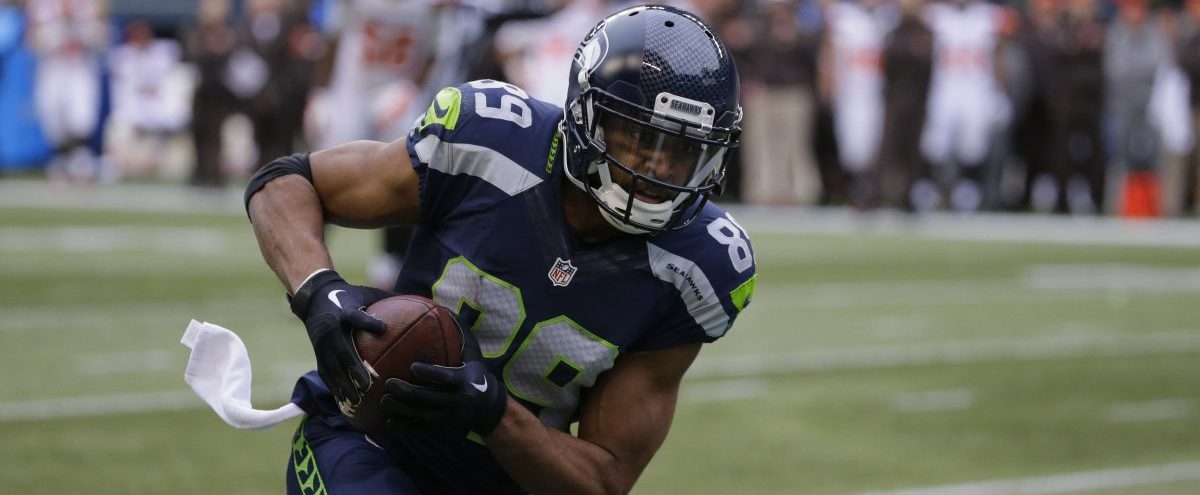 Seattle Seahawks' Doug Baldwin runs with the ball toward scoring a touchdown after catching it against the Cleveland Browns in the first half of an NFL football game, Sunday, Dec. 20, 2015, in Seattle. (AP Photo/Ted S. Warren)
