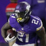 Minnesota Vikings running back Jerick McKinnon (21) tries to break a tackle by New York Giants defensive back Andrew Adams (33) during the first half of an NFL football game Monday, Oct. 3, 2016, in Minneapolis. (AP Photo/Andy Clayton-King)