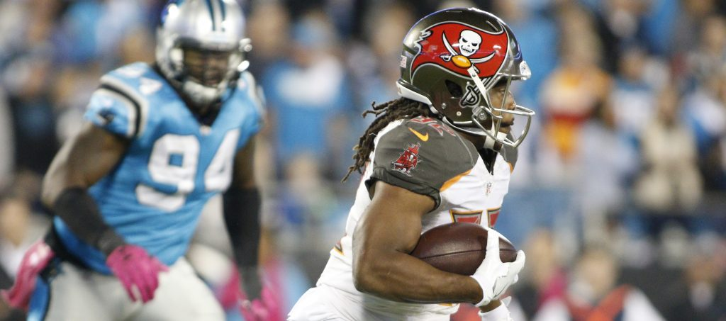 Tampa Bay Buccaneers' Jacquizz Rodgers (32) runs against the Carolina Panthers in the first half of an NFL football game in Charlotte, N.C., Monday, Oct. 10, 2016. (AP Photo/Bob Leverone)