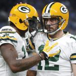Green Bay Packers wide receiver Davante Adams, left, celebrates his 9-yard touchdown reception with quarterback Aaron Rodgers (12) against the Detroit Lions during an NFL football game in Detroit, Monday, Jan. 2, 2017. (AP Photo/Paul Sancya)