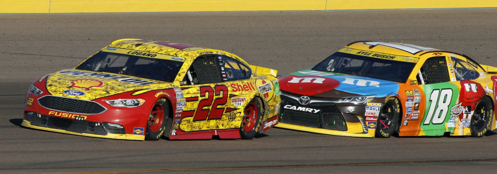 Joey Logano (22) drives out of Turn 4 ahead of Kyle Busch during the NASCAR Sprint Cup Series auto race at Phoenix International Raceway, Sunday, Nov. 13, 2016, in Avondale, Ariz. (AP Photo/Ralph Freso)