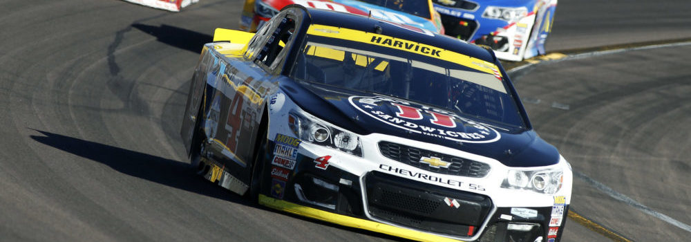 Kevin Harvick (4) drives out of Turn 4 during the NASCAR Sprint Cup Series auto race at Phoenix International Raceway, Sunday, Nov. 13, 2016, in Avondale, Ariz. (AP Photo/Ralph Freso)