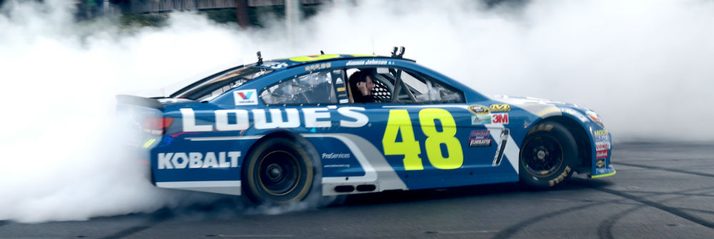 LAS VEGAS, NV - DECEMBER 01: Jimmie Johnson celebratory burnout in the middle of the Las Vegas Strip as part of NASCAR Champions Week Activities in Las Vegas, Nevada on December 1, 2016. Credit: mpi34/MediaPunch/IPX